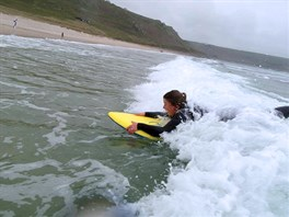 Learning to surf at Black Rock Sands in North Wales